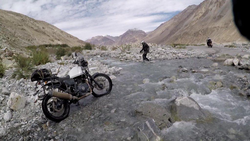 Biker Crossing a water stream